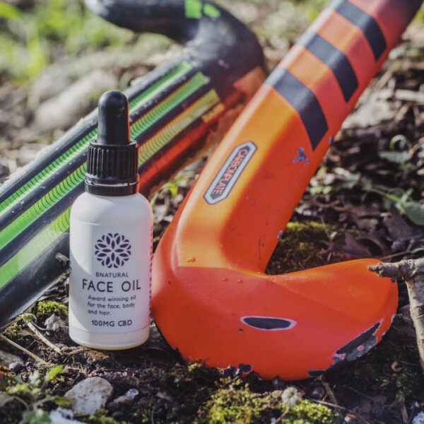 30ml Bottle of Bnatural Face Oil next to hockey stick. Contains 100mg CBD